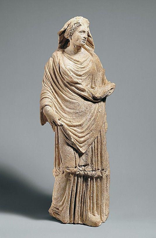 Terracotta statuette of a draped goddess  Period: Classical Date: late 5th–4th century B.C. Culture: Greek