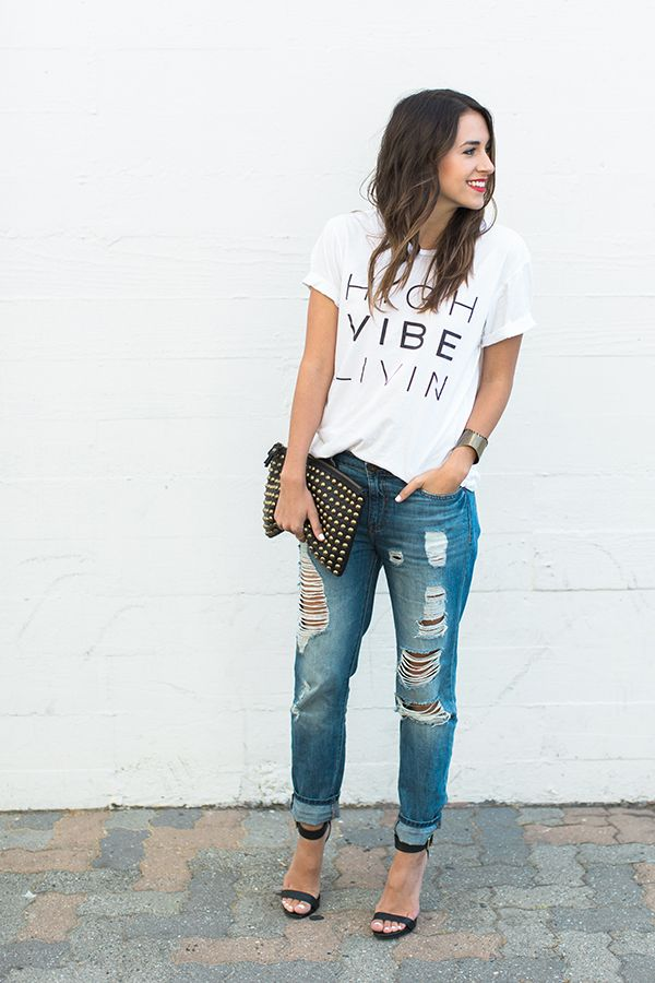 Graphic t-shirt, boyfriend jeans, barely there heels, studded clutch and bright lipstick.