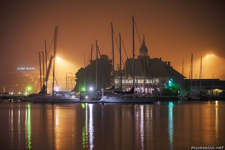 taivasalla.net - Under the Open Sky - September 2014. Helsinki: Valkosaari island located outside the South Harbour seen from the shore of Kaivopuisto district on a foggy autumn night. The building with the tower is a summer restaurant