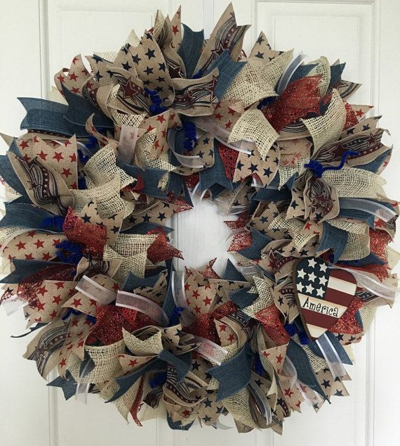This gorgeous Americana wreath is perfect for any holiday, Memorial Day, 4th of July, Flag Day or just everyday to show your American pride! Tons of layers, textures and colors for great visual appeal. Made with natural ribbons printed with stars, burlap, sparkly red ribbon, white