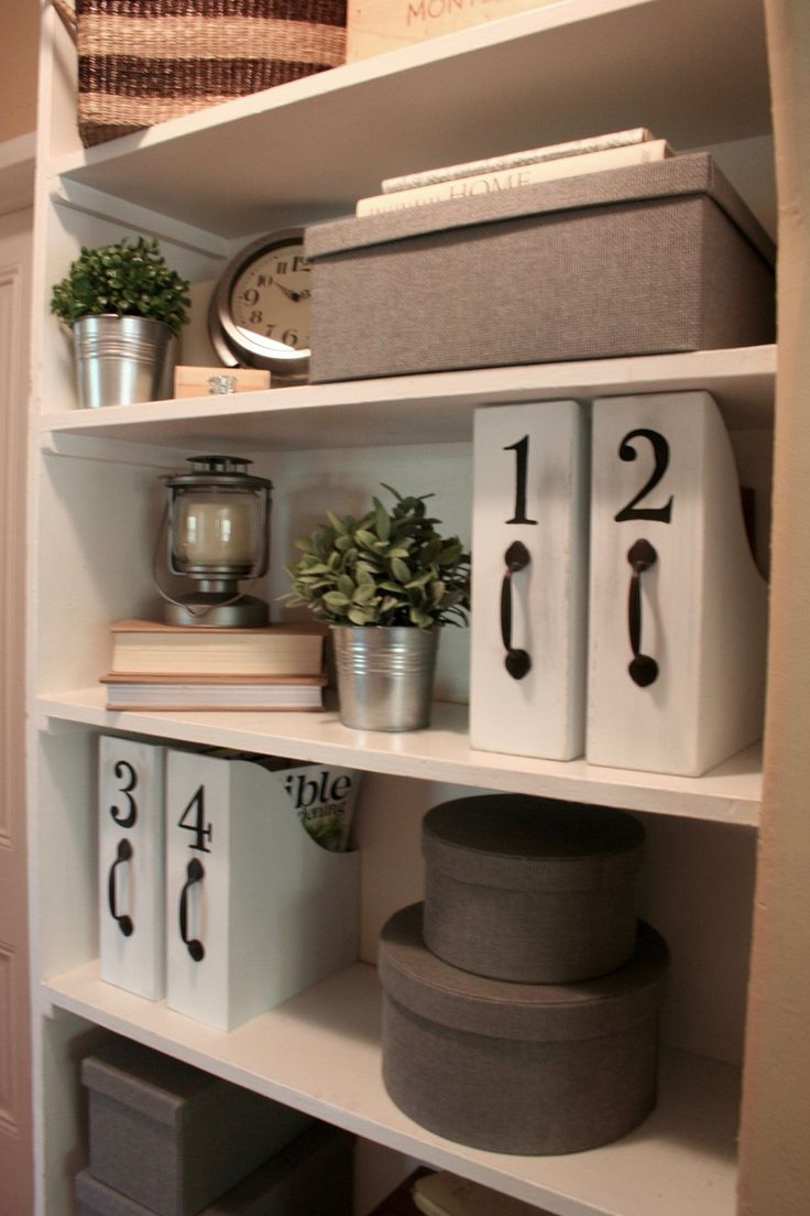 Living in a small house, I have to find storage wherever I can. There is  one built in shelf in my hall that I use for storage. I have got all kinds  of goodies hiding in those gray Ikea Kvarnvikboxes:wrapping paper, ribbon  . . .
