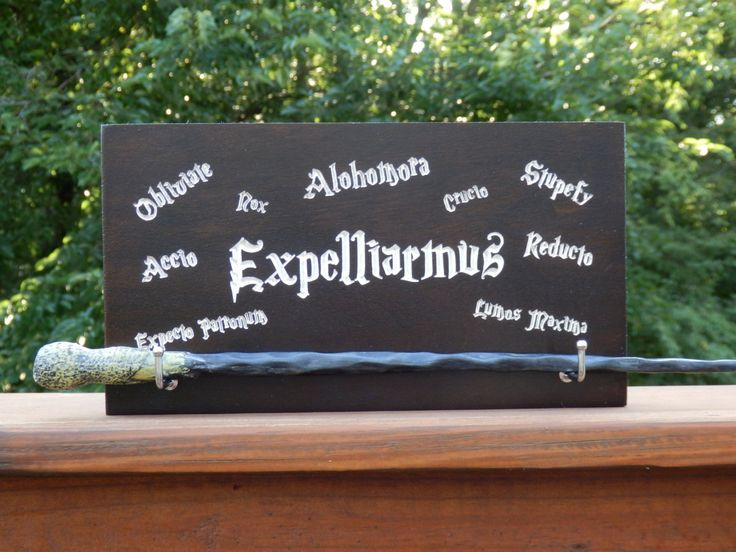 Harry Potter Wand Display, Magic Wand Stand - Expelliarmus Spell - Great Gift Idea for a Harry Potter Fan, Harry Potter Decoration Ideas by WoodDesigns4You on Etsy https://www.etsy.com/listing/459494794/harry-potter-wand-display-magic-wand