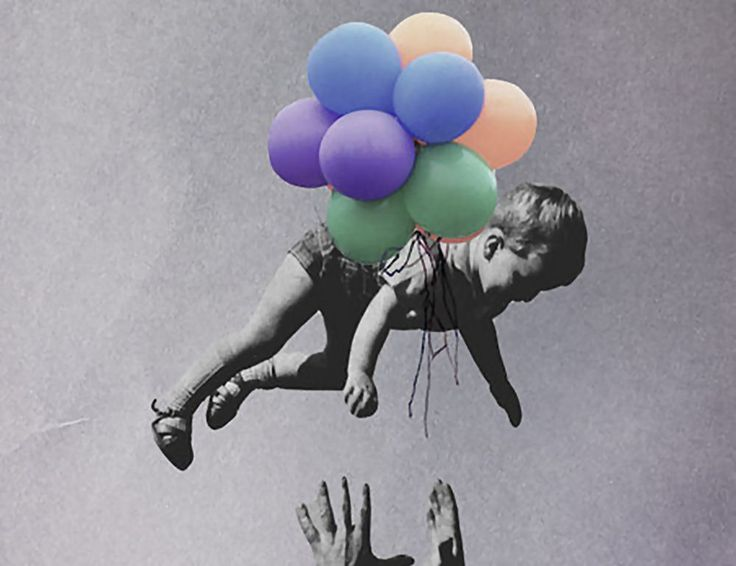child flying with balloons