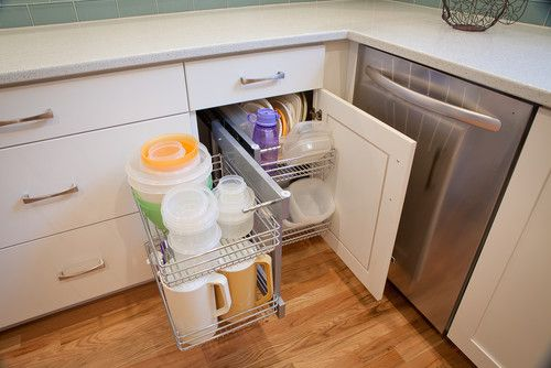 kitchen with wood flooring and cupboard organizers