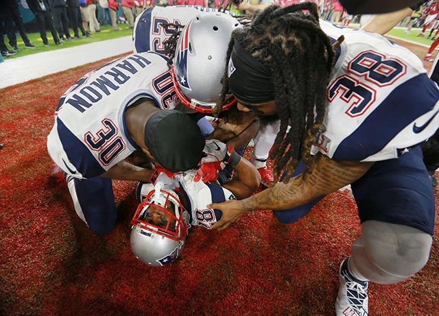By Jim Davis/Globe Staff -- From left, Patriots players Duron Harmon, LeGarrette Blount and Brandon Bolden celebrate with James White (on ground) after White scored the game winning touchdown in overtime.  #nfl #football #SuperBowl #SuperBowl51 #SuperBowlLI #Houston #patriots #patsnation