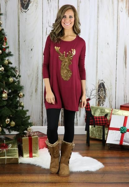 Get into the Holiday spirit with this super adorable tunic! Features 3/4 sleeve and gold sequin reindeer. Pair with our reindeer slippers for a cute Christmas style!