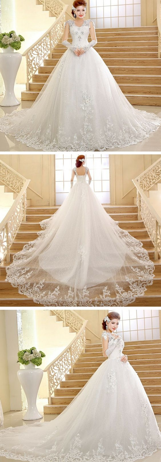 A dazzling tulle ball gown wedding dress with crystals and lace. It's easy to see why this stunning wedding dress is one of our most popular. It's affordable and gorgeous. Use code PTL20331 to get an lower price.