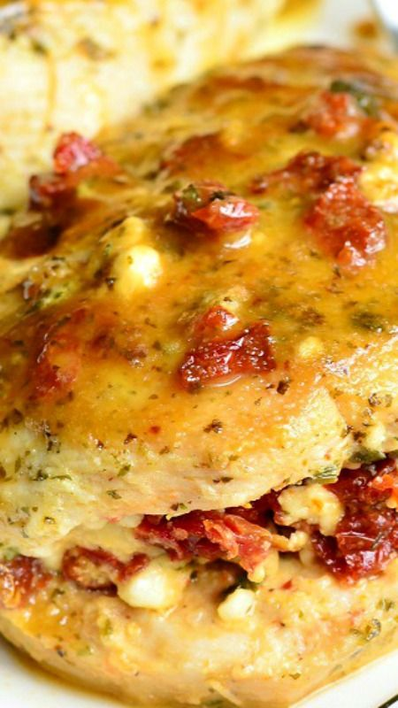 Sun Dried Tomato Feta Stuffed Chicken ~ Amazingly flavorful pan-grilled chicken that is stuffed with a mixture of sub dried tomatoes and feta cheese and rubbed with fresh pesto... Easy, fast and incredibly delicious