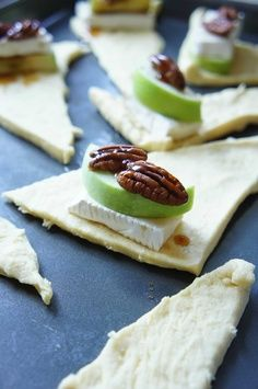 crescent rolls 1 slice of brie 1 slice slice of tart apple  2 pecans  a drizzle of honey 375 oven - 13 to 15 minutes