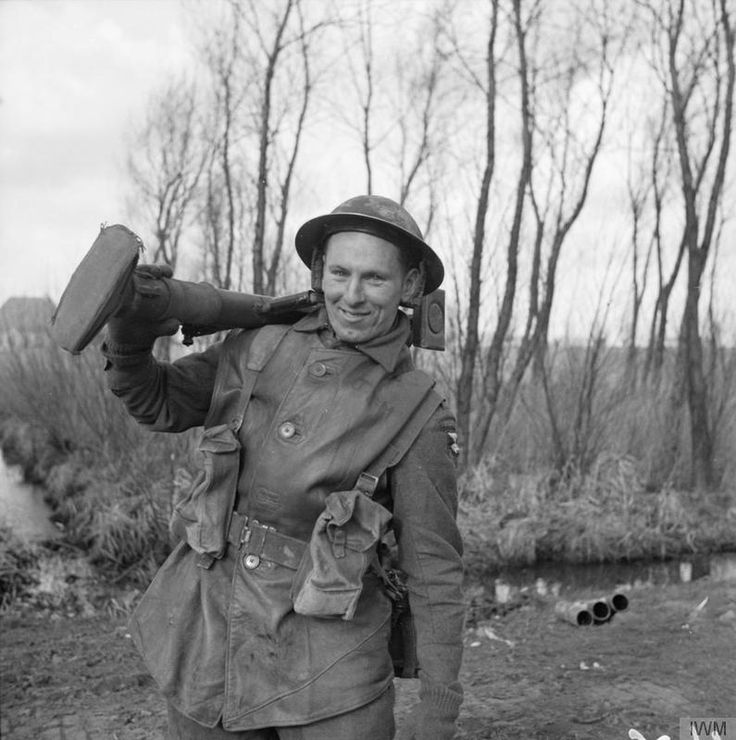 Private G. Mills of 2nd Gloucestershire Regiment, armed with a PIAT, 6 March 1945.