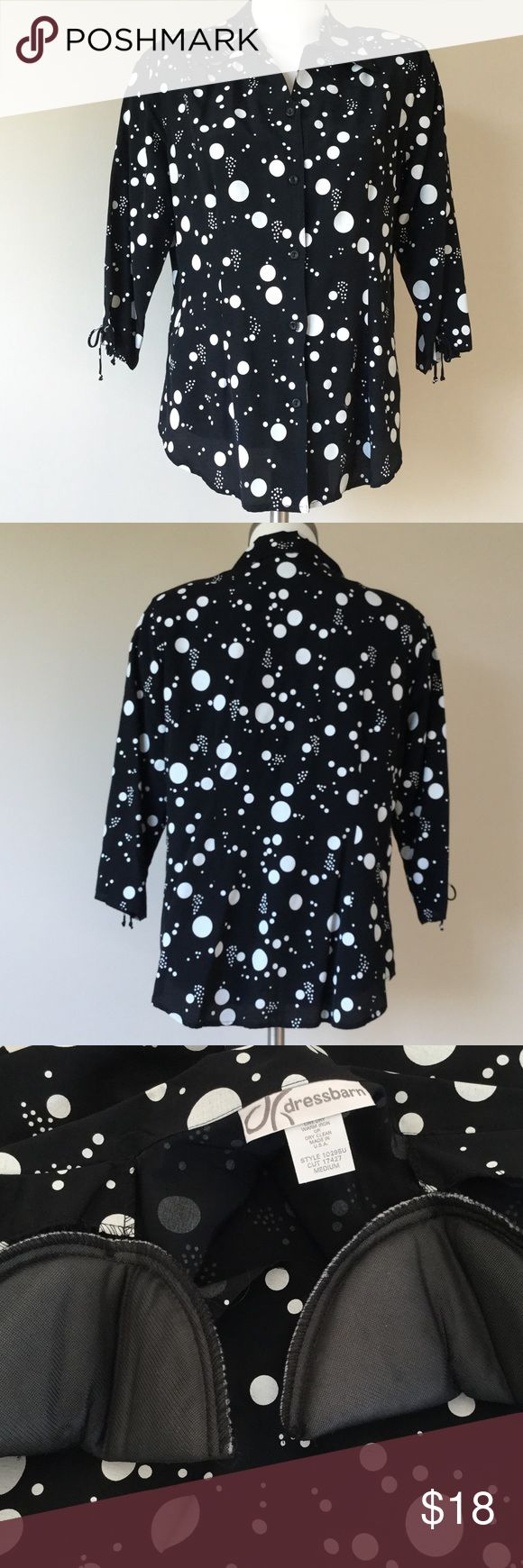 Dressbarn Polka Dot Blouse w/ shoulder pads 🆕 DressBarn Black and White Polka Dot Blouse. A beautiful soft and flowing blouse featuring shoulder pads, and white polkadots of various sizes. Excellent condition! 53% acetate 47% rayon. Size medium. Dress Barn Tops
