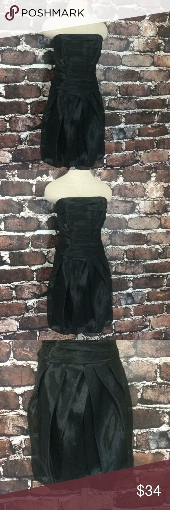 """Vera Wang black strapless dress 12 ruffles organza This dress is ready for your next event. Layered bodice and pleated at skirt. Shell has lots of volume at skirt as the hem is sewn under to meet the lining creating a bell shape. All black and in great condition! Mannequin is an xs and doesn't quite fill out this dress. 18"""" armpit to armpit. 30.5 """" in center of front. 32"""" waist.  Wired boning on sides. White by Vera Wang bell strapless party dress black size 12. White by Vera Wang Dresses…"""
