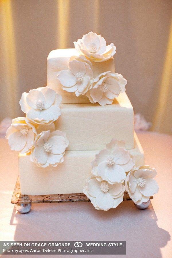 simple cream wedding cake with white sugar