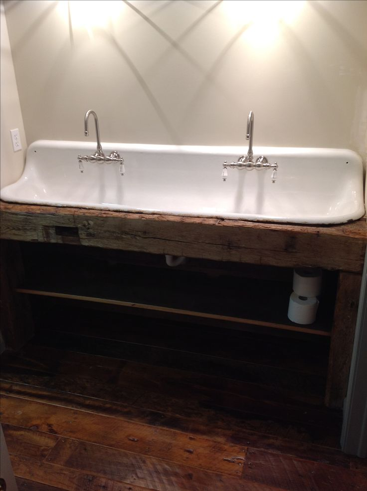 This porcelain sink was repurposed from an old urinal- don't worry it's completely clean now! It sits on a barn beam to add a rustic look! We still have one sink like this left and can customize it to fit in your home! Contact us on Facebook.com/CherryPickersIN to get started!