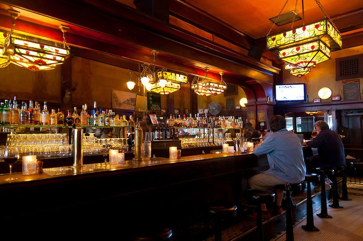 tiffany lights in bar | The antique bar with Tiffany glass style light fixtures at McMenamin's ...