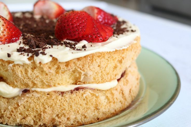 A deliciously light and fluffy Thermomix Sponge Cake filled with jam and cream.
