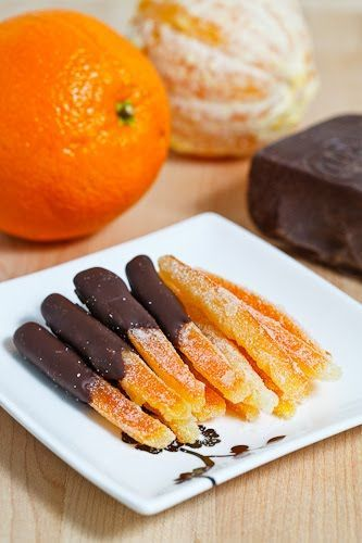 Candied Orange Peel dipped in Dark Chocolate. - fabulous way to use up waste from juicing oranges + the syrup they are cooked in can also be used in cocktails, pancakes, teas, etc! <3