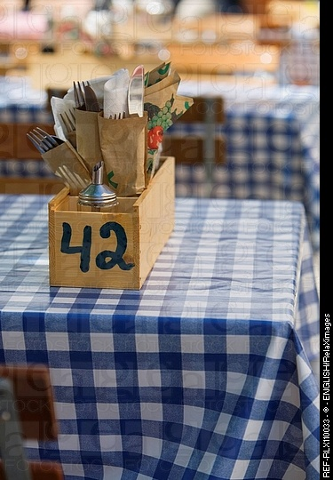 Cutlery in wooden box on typical German beer garden table