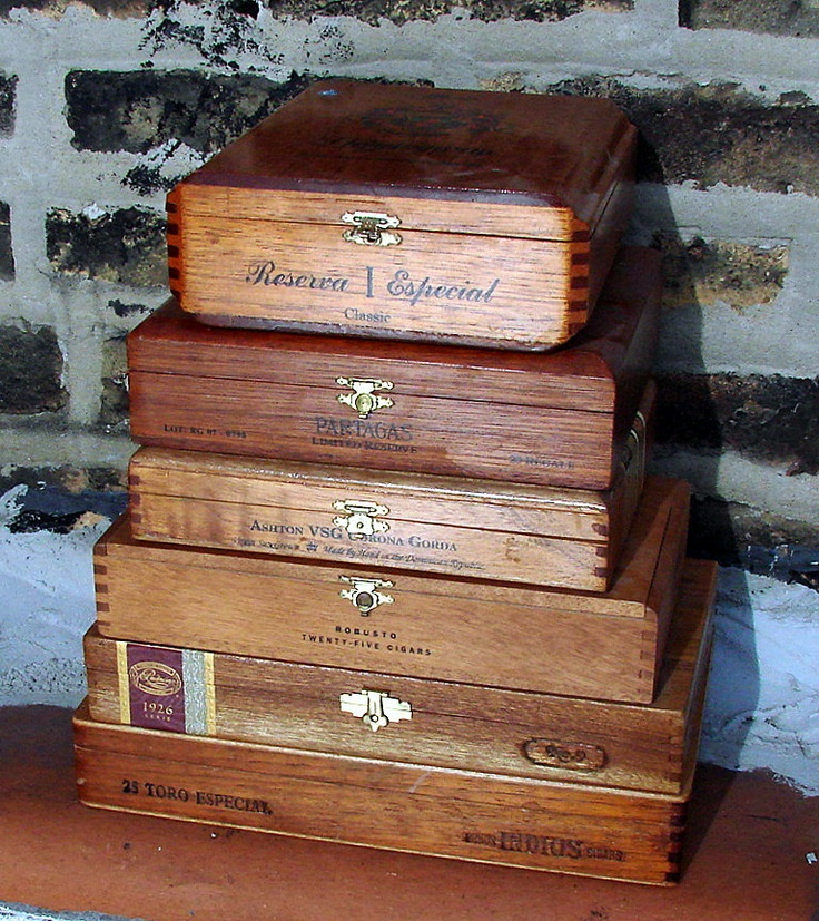 Vintage cigar boxes for storage and display.  I use these to add height.  Plus...if I can stack 'em...I love 'em!