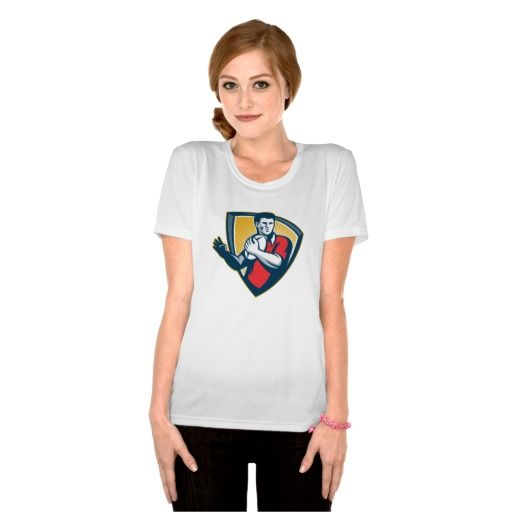 Rugby Player Running Ball Shield Retro T Shirt. Rugby World Cup women's t-shirt showing an illustration of a rugby player running with the ball set inside crest shield done in retro style. #rwc #rwc2015 #rugbyworldcup