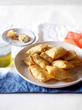 Cheese and mint kalitsounia..my uncle makes these every greek easter and everytime we have a gathering. i only like them when he cooks them.. but this recipe looks pretty good too!! they are AMAZING!