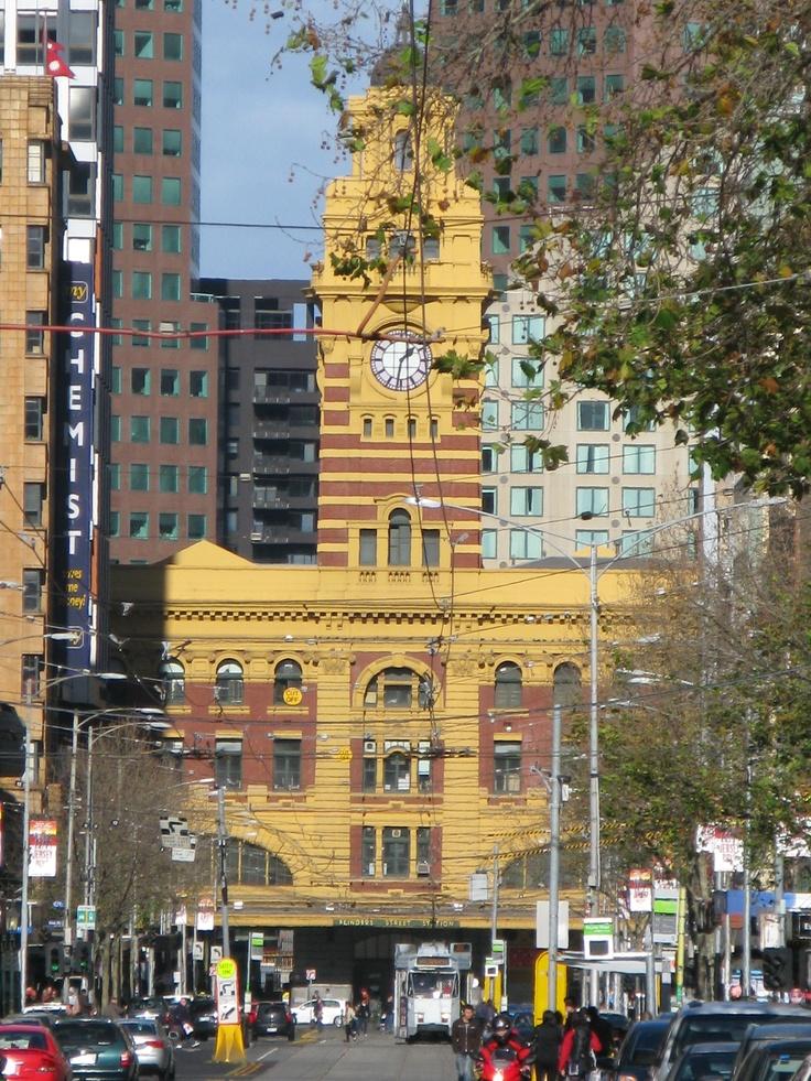Flinders Street Station and Flinders Street seen from Elizabeth Street. Melbourne Victoria Australia