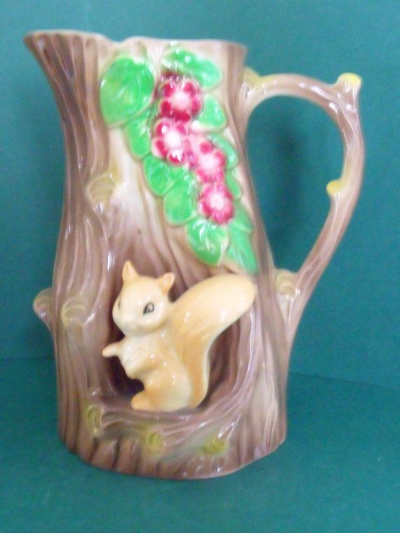 Lovely vintage Hornsea fauna royal pottery tree trunk jug. At the jug's base there is a little squirrel standing under red blossom