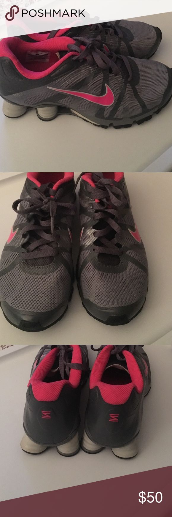 Gently used Nike shocks size 8.5 grey/pink Gently used Nike shocks size 8.5 grey and pink, only worn a handful of times Nike Shoes Sneakers