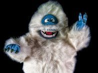 Bumble - It was discovered in the 1964 stop-motion animation TV special, Rudolph the Red-Nosed Reindeer that the flying reindeer have socialized with a fellow cryptid, the Bumble, a yeti-like creature known as the Abominable Snow Monster of the North. The large, white Bumble has the ability to bounce, but is prone to sinking. The creature is also apparently enraged by glowing red noses and all things connected to Christmas -- but legend has it that it can be domestic by removing its teeth.