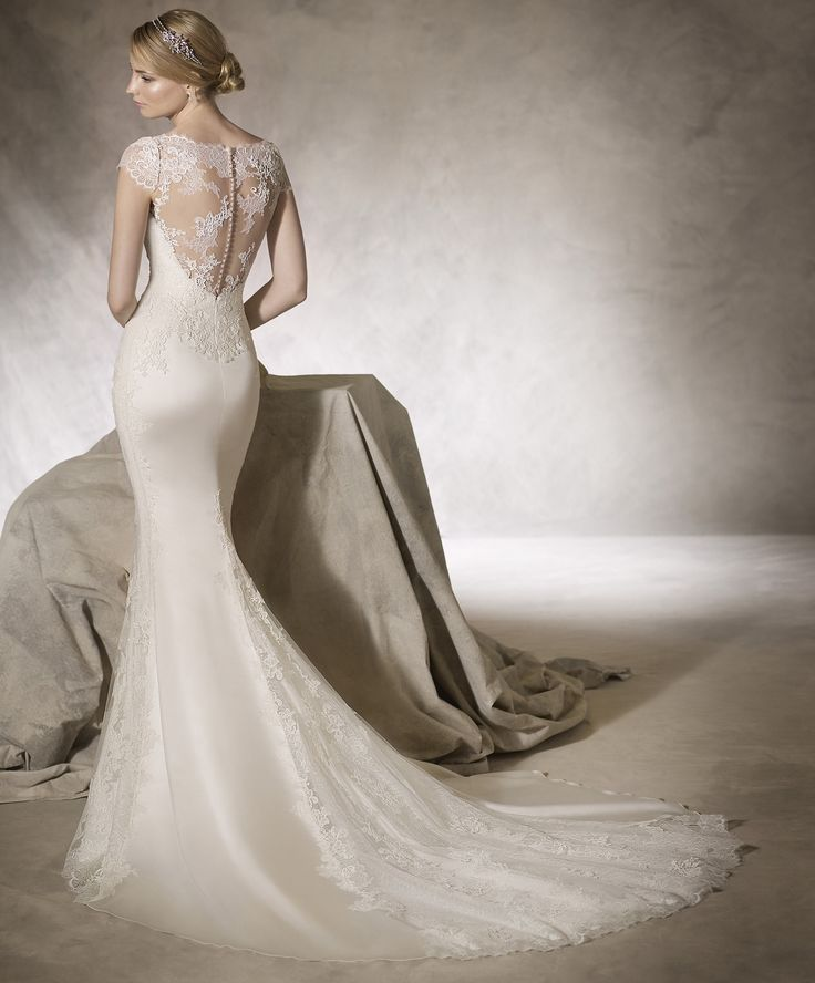 HAMAN // Morbid satin and embroidered tulle is used to create this luxurious wedding gown with a low illusion back and soft-lace cap sleeves