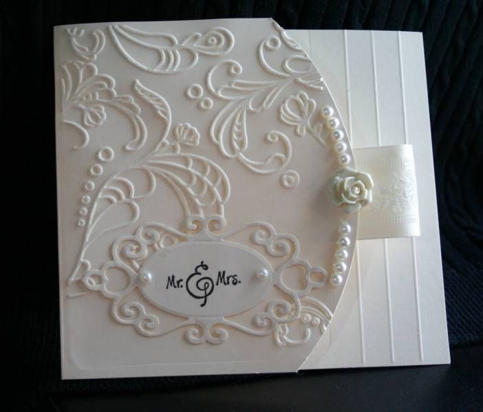 Beautiful embossing and monochromatic color scheme. It reminds me of iced cake decorations.
