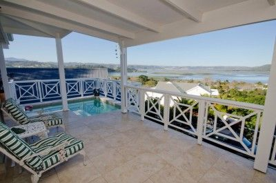 This property has to be seen to be believed! The home features an open plan extra spacious state of the art lounge/dining room with fire place leading onto undercover patios, and pool overlooking the Knysna Lagoon. Open plan kitchen with separate scullery and guest cloak room.