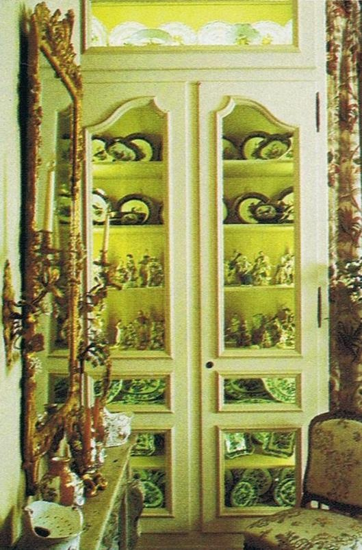 Switzerland residence. This photo is from a 25 year old magazine. Vitrine filled with favorite objects to the right of fireplace. House and Garden Dec. 85 Trouvais