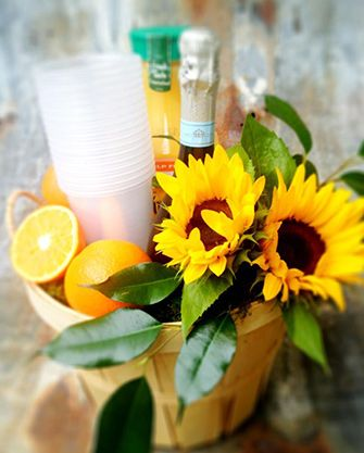 Mimosa gift basket idea for a hostess gift for party or dinner party....orange juice, champagne, flowers, cute glasses, decanter, etc