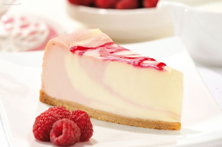 """""""New-York Cheesecake with Raspberries""""  creates a positive summer mood, regardless of the time of year and the weather outside. In this dessert observed practically jewelry balance between moderate sweetness of the cream cheese and raspberries intelligent sourness."""