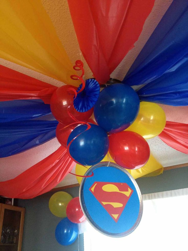 Superman/superhero ceiling decoration using balloons and tablecloths, can also use streamers