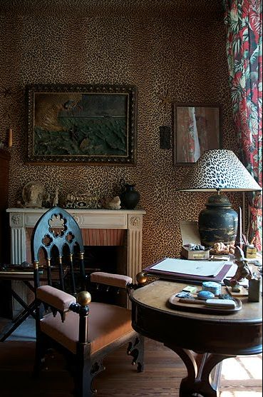 I love the warmth of this leopard-print filled room. Love the chair, too.
