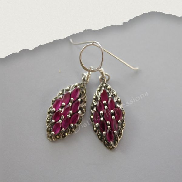 Pink Corundum Earrings. These earrings bring together Pink Corundum and marcasite to create a classic design. See also matching ring