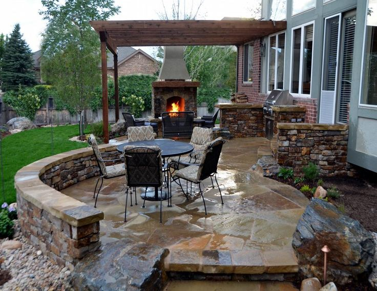 flagstone patio with stone fireplace and outdoor kitchenjpg provided by mile high landscaping denver - Stone Patio Designs With Fire Pit