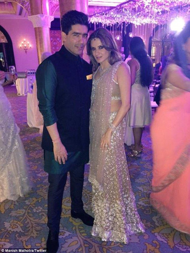 Designer: Fashion boss Manish designed some of bride Anu's outfits - including this stunni...