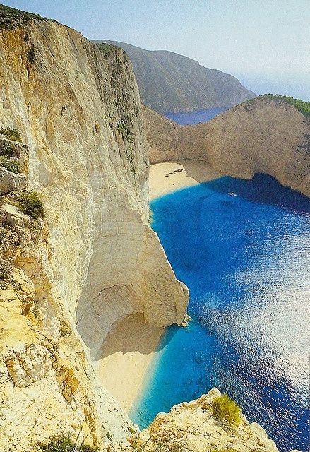 Zakynthos Island, Greece. - The most famous landmark of the island is the Navagio beach. It's a cove on the southwest (northwest near village of Anafonitiria) shore, isolated by high cliffs & accessible only by boat. The beach & sea floor are made of white pebbles, and surrounded by turquoise waters. It's named after a shipwreck (MV Panagiotis), which sunk on the shore around 1980.