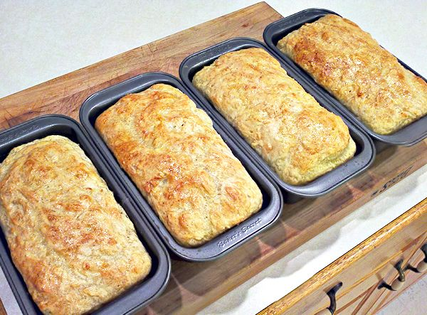 Carole's English Muffin Bread --   5 1/2 cups warm water  3 packages RAPID RISE yeast  2 Tablespoons salt  3 Tablespoons sugar  11 cups bread or All Purpose flour