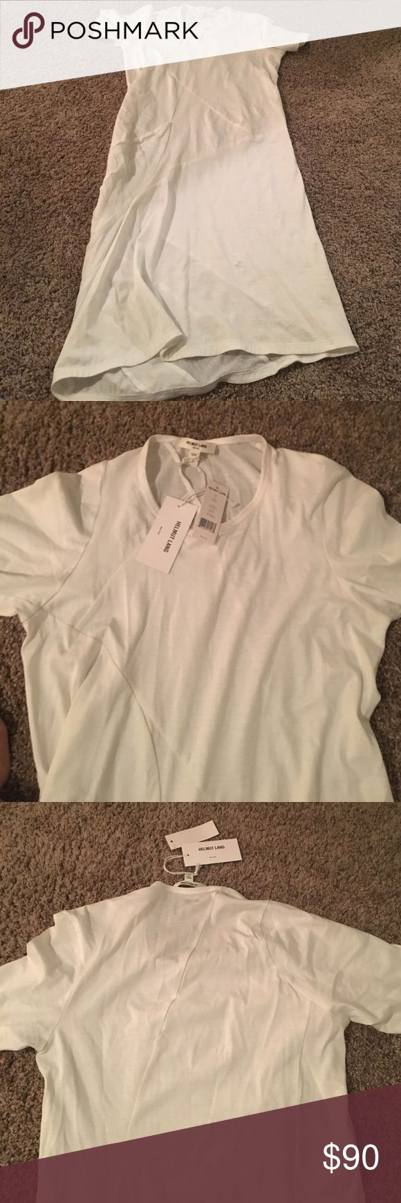 NWT helmut Lang long white short sleeve top NWT white long short sleeve cotton jersey helmut Lang top in size P which is XS. The top has such detail and really is a great fabric. Originally $185. Open to offers! Helmut Lang Tops Tees - Short Sleeve