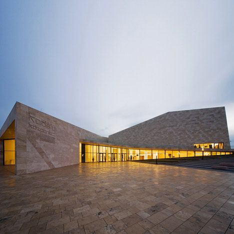 This faceted stone building by Hungarian architects Építész Stúdió contains a concert hall