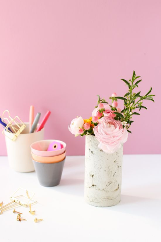 Fill a concrete vase (and your favorite room) with the vibrant color of spring blooms.