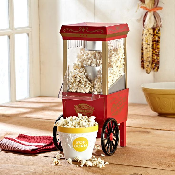 Make theatre-style popcorn right at home with this vintage popcorn maker. The kids will love it! Traditional look popcorn cart uses air to pop kernels instead of oil, making a healthy, low-calorie snack. Unlike microwave popcorn, with the Nostalgia Electrics Vintage Popcorn Maker you decide if you want to add salt and butter or use alternative health conscious spices to add flavour to your snack.