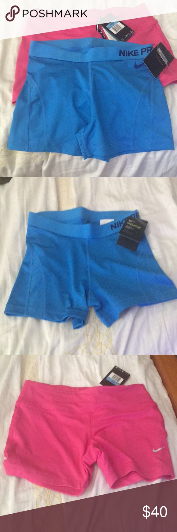 Nike Compression shorts New with tags Nike compression shorts. Great for training or running. Blue is a Nike Pro  Hypercool and Pink is a Dri fit shorts. Nike Shorts