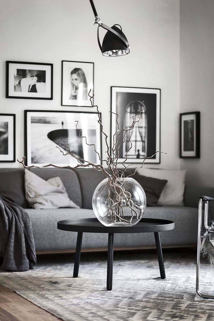 Black and white living room, with round glass bowl in focus. And Printler art in the background, by photographer @onlycimek. Available as poster and laminated picture at printler.com. Direct link -> https://printler.com/sv/foto/9241