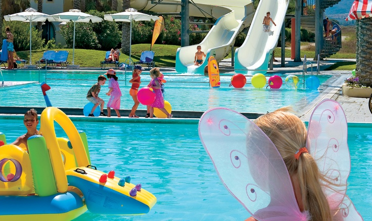 Family all inclusive resort vacations in Kos; it's our job!The Grecotel Royal Park all inclusive family resort in Kos Greece set on a beautiful sandy beach and surrounded by farmland and countryside, this all- inclusive family hotel in Kos exudes an air of calm and relaxation. This family resort offers large colourful gardens that encircle the pretty garden bungalows and main building.  On the long sandy beach there are endless quiet spots for sunbathing.