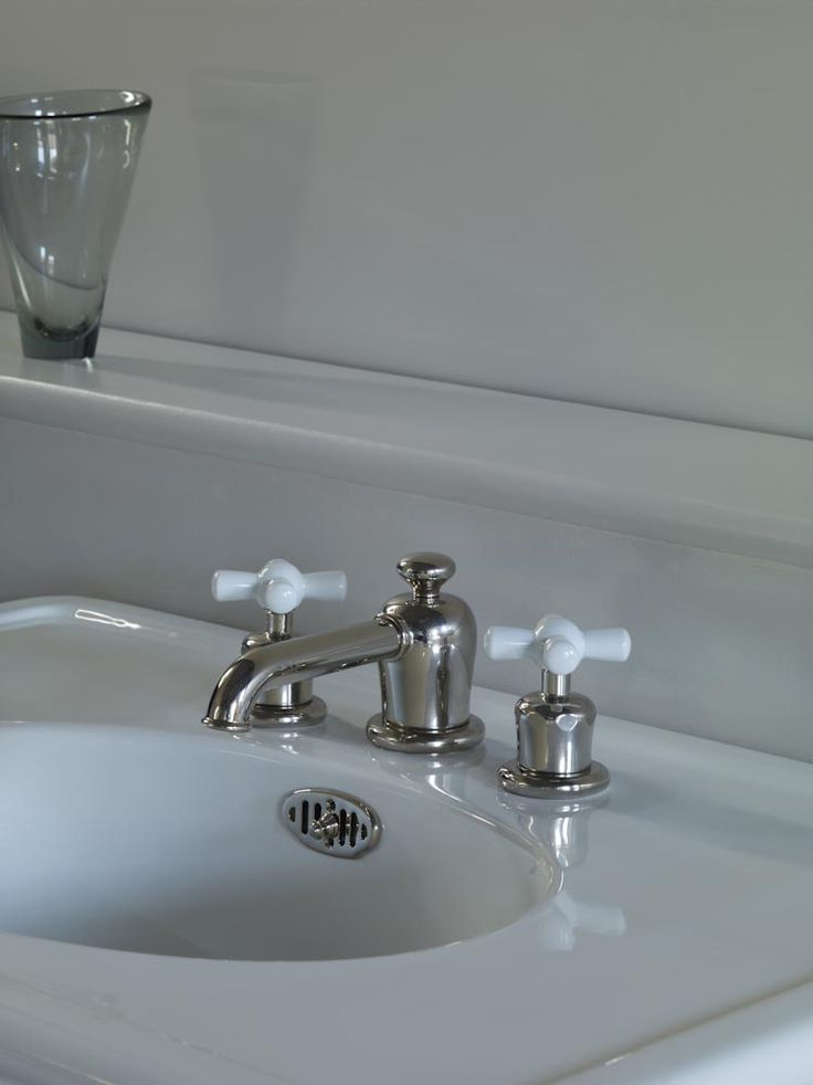 Rockwell three hole deck mounted basin mixer with white crosshead valves shown here in polished nickel. #white #taps #Rockwell #watermonopoly